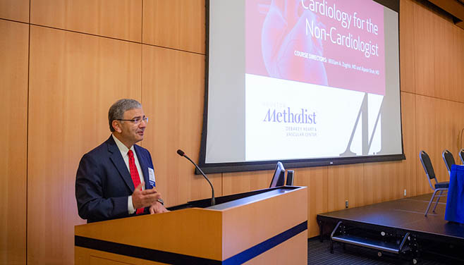 Dr. William Zoghbi stands at the podium speaking to attendees at the beginning of the Cardiology for the Non-Cardiologist conference