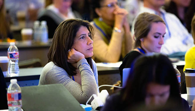 An attendee looks on with interest at the Heart Failure Summit.