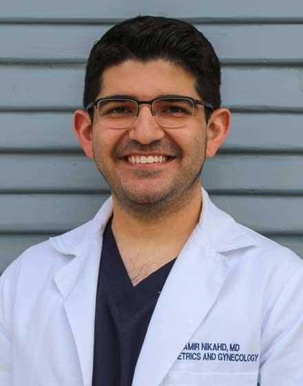 headshot of Amirhossein Nikahd, MD