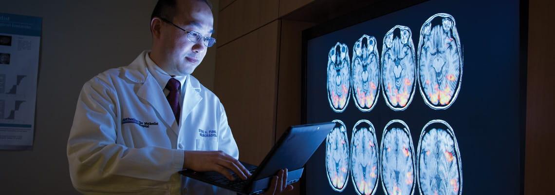Neurologist exmine MRI scans