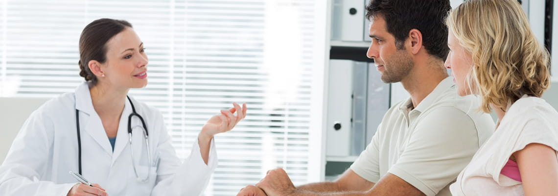 Physician at Houston Methodist Obstetrics and Gynecology Group consulting with couple