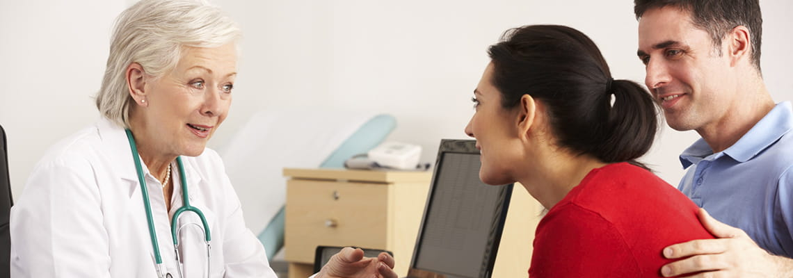 Methodist Pulmonary and Sleep Medicine Associates pulmonary specialist conferring with patient and spouse