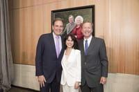 Photo (left to right) CBS Sports Commentator Jim Nantz, Maria Bush and Neil Bush stand in front of a portrait of Barbara and President George H.W. Bush at the naming ceremony of the Barbara and President George H.W. Bush Atrium at the new Walter Tower at Houston Methodist Hospital.