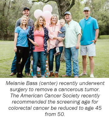 Melanie Bass (center) recently underwent  surgery to remove a cancerous tumor.  The American Cancer Society recently  recommended the screening age for  colorectal cancer be reduced to age 45  from 50.