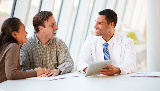 Physician providing face-to-face consultation to patients