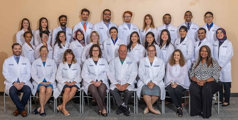 group photo of 2021-2022 family medicine residents, seated