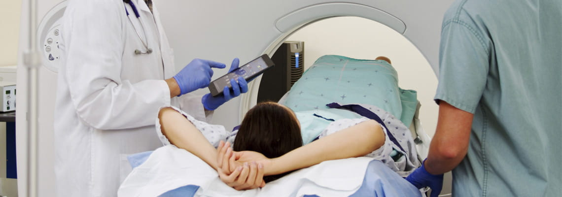 Orthopedic surgeons prepare patient for CT scan