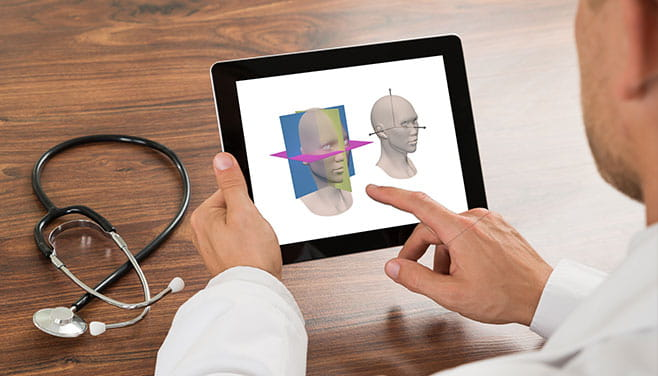 Doctor using AnatomicAligner, a new FDA-approved Methodist-built software program, on an iPad.