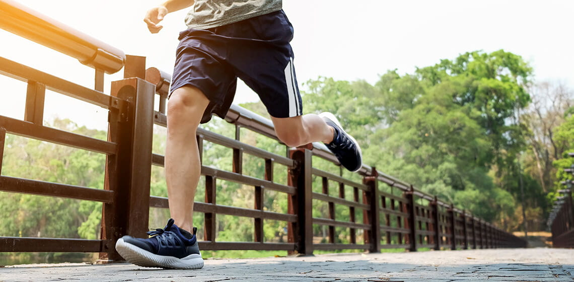 man running displaying foot and ankle