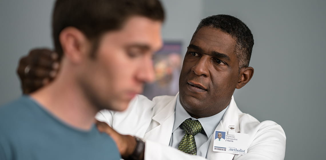 man having neck examined by doctor