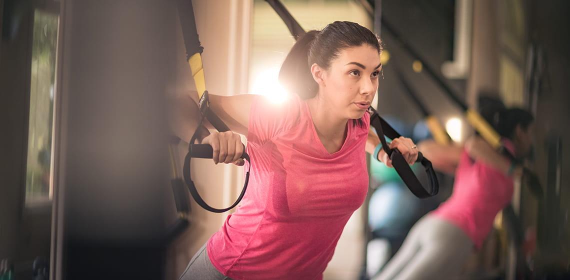 woman exercising using shoulders